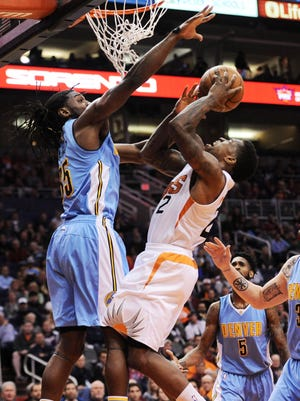 Dec 23, 2015: Phoenix Suns guard Eric Bledsoe (2) goes up for a shot over Denver Nuggets forward Kenneth Faried (35) during the first half at Talking Stick Resort Arena.