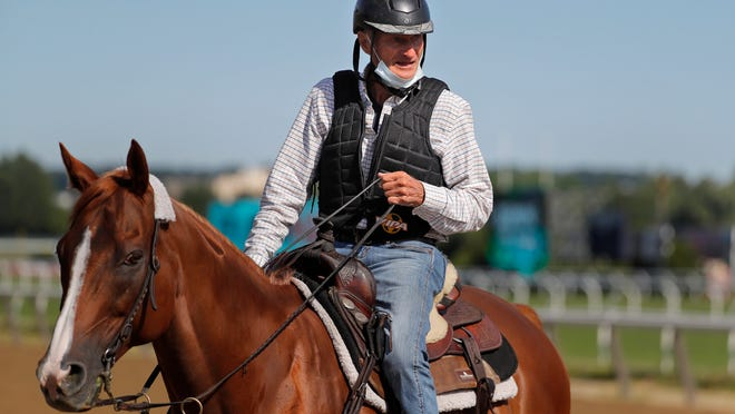 Tiz The Law trainer Barclay Tagg rides a horse on the main track during workouts at Belmont Park in Elmont, N.Y., Wednesday, June 17, 2020. Tiz the Law is the favorite in the 152nd running of the Belmont Stakes scheduled to be run on Saturday.
