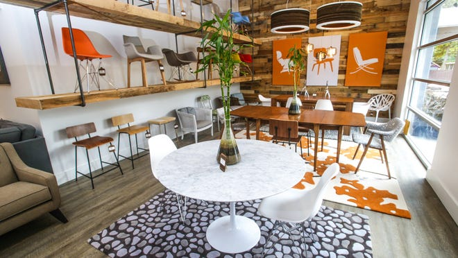 Novo Saarinen dining table $1,617 and Novo Cairo chairs, $132, at the new Inhabit showroom in Irvington.