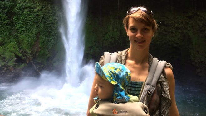 Lotta Zachrisson with her one-year-old son at Catarata waterfall in Costa Rica, proving that you don't have to stop going on hikes just because you are a parent.