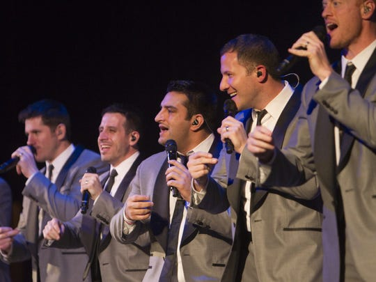 Members of the a cappella group Straight No Chaser perform in 2012.