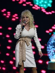 Dolly Parton talks to media and fans Friday, Aug. 18,