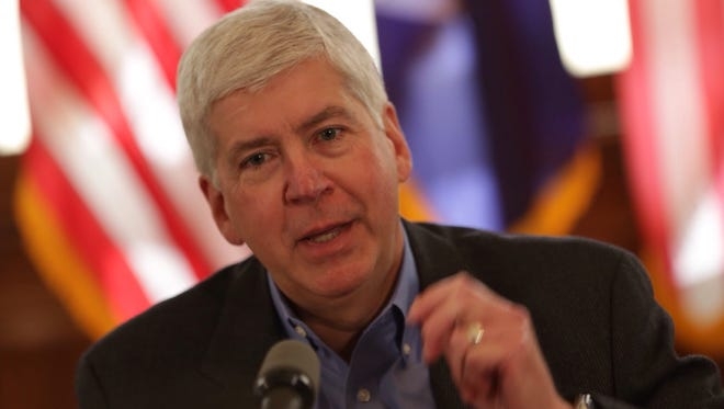 Michigan Governor Rick Snyder announces new details about education reforms in Detroit on Monday, Oct. 19, 2015.
