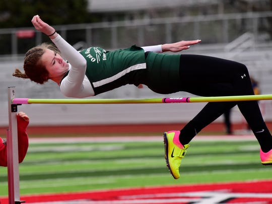 Oak Harbor's Peyton Bloomer competes in the girls high jump Tuesday.