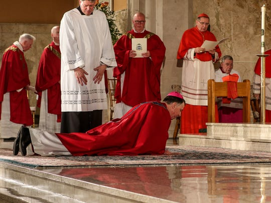The Most Rev. James Francis Checchio prostrates himself during the Litany of Supplication during his Episcopal Ordination and Installation as the Fifth Bishop of Metuchen at the Church of the Sacred Heart in South Plainfield on May 3, 2016.