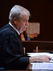 Collier Circuit Frederick Hardt presides over the championship round of the mock trial.