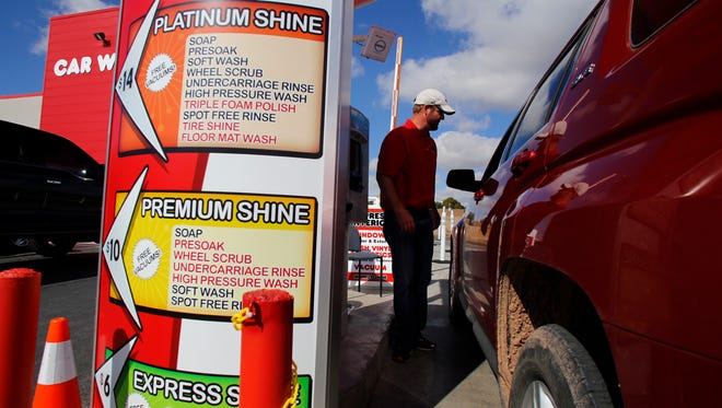 Monkey Shine Owner Chris Beal talks with a customer, Friday at his business in Farmington.