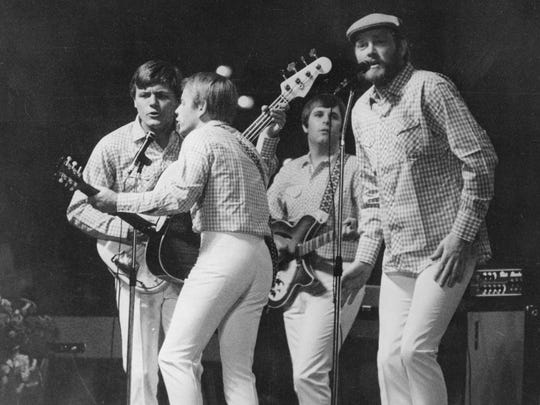 The Beach Boys perform on Oct. 30, 1966, in Essen, West Germany. The members on stage were Bruce Johnston on bass, (from left), Al Jardine on guitar, Carl Wilson on guitar and Mike Love on vocals. Not pictured are Dennis Wilson (on drums) and Brian Wilson (who wasn't touring with the group anymore by this point).