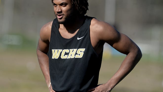 Winchester's Kiante Enis smiles after competing in the 100 m dash Wednesday, April 13, 2016, in Hagerstown.