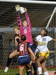 Hershey goalie Micah Nicolson lets slip through her hands a shot by Elco Raider Jordan Rosengrant.