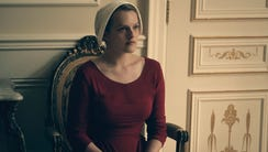 Under his eye: Elisabeth Moss stars as a woman whose