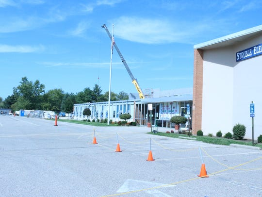 Students at schools on the construction sites can see