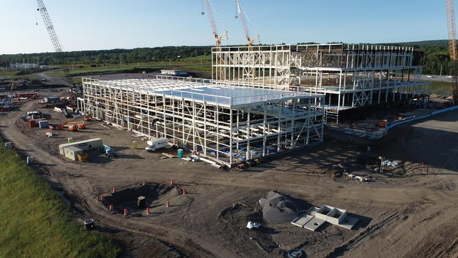The frame of the central utility building, shorter structure in the front, and the fabrication facility is rising at the Marcy Nanocenter. Cree, Inc. is building a $1 billion 200 mm silicon-carbide wafer fabrication facility, which is expected to begin production in 2022.