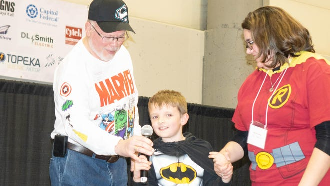 A boy dressed as Batman talks during the Capper Foundation's annual fundraiser An Evening for a Child.