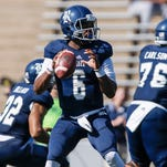 Oct 25, 2014; Houston, TX, USA; Rice Owls quarterback Driphus Jackson (6) looks for an open receiver during the first quarter against the North Texas Mean Green at Rice Stadium. Mandatory Credit: Troy Taormina-USA TODAY Sports