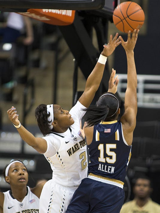 Notre Dame's Lindsay Allen (15) shoots over Wake Forest's Amber Campbell (2) in first half of an NCAA college basketball game Thursday,  Feb. 18, 2016, in Winston-Salem, N.C. (AP Photo/Lynn Hey)