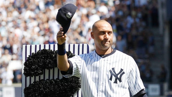 Derek Jeter tips his cap to the crowd at a ceremony honoring him at Derek Jeter Day on Sept. 7.