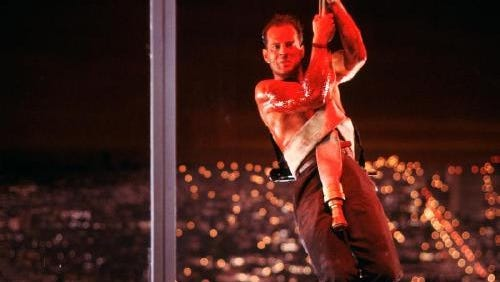 """Bruce Willis crashes his wife's company Christmas party in """"Die Hard."""""""