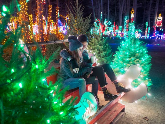 "Vienna Soyke, left, and Abby Sutherland take a break in the sleigh at ""Christmas Magic: A Festival of Lights""at Rocky Ridge County Park in Springettsbury Township."