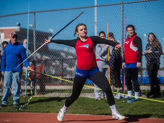 Madi Smith competes in the javelin event during the track meet on March 29, 2016.