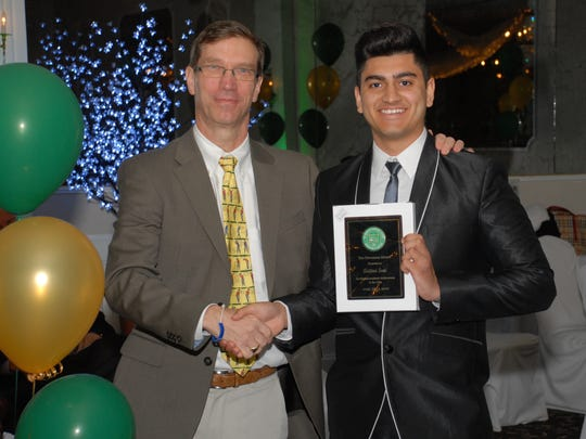 Astitva Soni receiving the Stevenson Award for highest academic achievement in the class. He is pictured with Dr. Bob Bowman of Scotch Plains, our Assistant Head of School for Upper School.