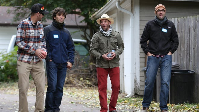 (Left to right) Kyle Rossetter, Enrico Lo Gatto, Craig Lee and Alex Jimenez play bocce in a back alley just west of 42nd Street and College Avenue in 2014.