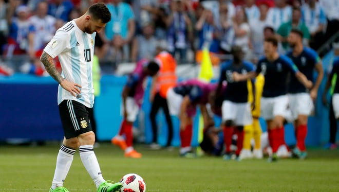 Lionel Messi reacts during the game as Argentina is eliminated from the World Cup by France in the Round of 16.