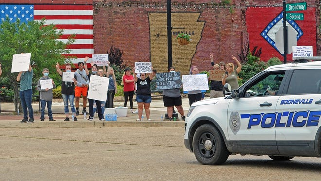 People gather on the corner of N. Broadway and W. Second Street in Booneville during a Black Lives Matter demonstration on Thursday, June 4, 2020. Several protest were held around the area on Thursday and another is planned for Saturday in Fort Smith at the intersection of Jenny Lind Road and Zero Street from 11 a.m. to 3 p.m.