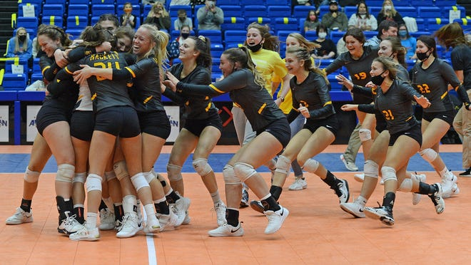 The Hackett volleyball team celebrates after winning the 3A state championship game in the Hot Springs Convention Center on Saturday, Oct. 31. Hackett defeated Paris 3-0. Greenwood and Mansfield also won state titles is their divisions.