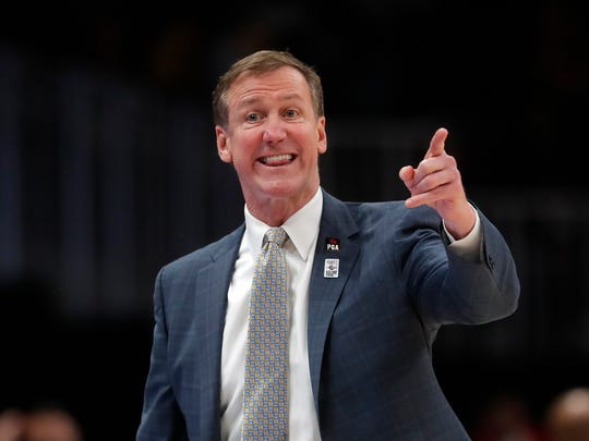Portland Trail Blazers head coach Terry Stotts speaks to an official in the first half of an NBA basketball game against the Atlanta Hawks, Friday, March 29, 2019, in Atlanta. (AP Photo/John Bazemore)