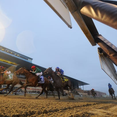 Tonalist, left, got up in the final strides to win