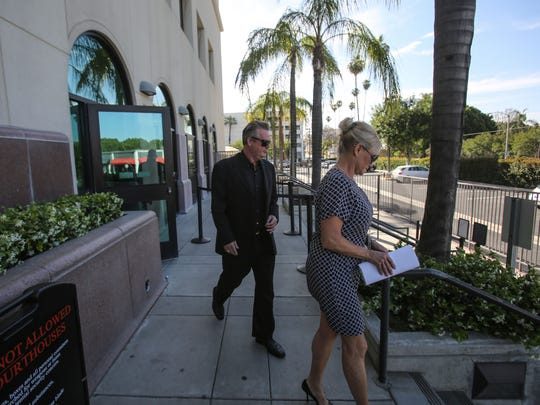 Bribery suspect Richard Meaney and his wife, Heidi Meaney, leave the Riverside Hall of Justice Friday after a brief appearance in Riverside County Superior Court.