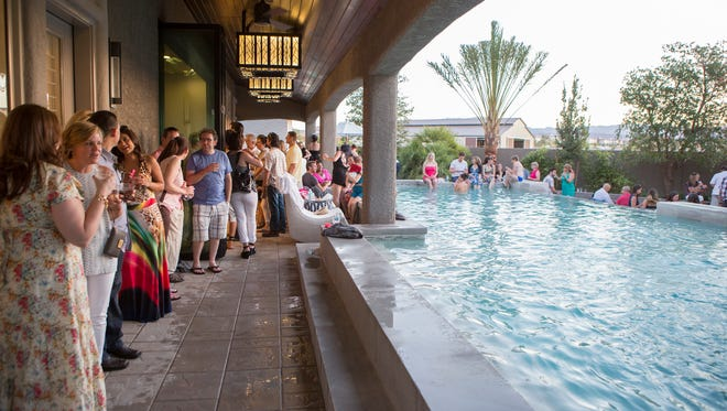"Party guests enjoying the pool at the home of Drew and Jonathan Scott in Las Vegas, as seen on HGTV's ""The Property Brothers at Home."""