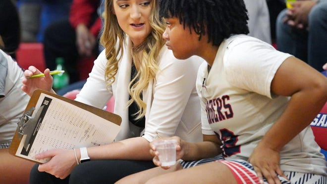 McKenna Weaver (left) talks to Carl Sandburg College freshman Destiny Allen during the Chargers' win over Illinois Valley on Feb. 13 at John M. Lewis Gymnasium. Weaver, an assistant for the Chargers the past two seasons and a Sandburg alumna, has been named the program's new head coach.