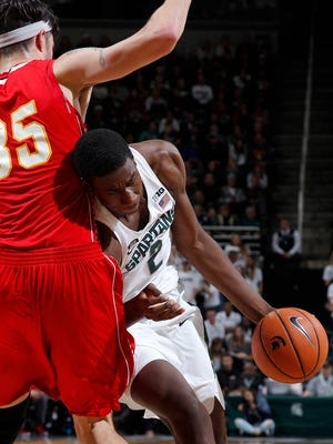 Michigan State freshman Jaren Jackson Jr. drives against Ferris State's Zach Hankins Thursday night. Jackson finished with 14 points and eight blocks.