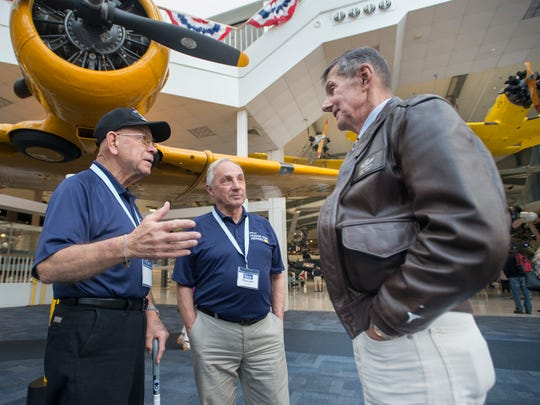 JetBlue's Honor Our Heroes program participants William Hegedus, of Port Chester, NY, left, and Ronald Prata, of Rye, NY, chat with museum docent Joe Kinego, right, at the National Naval Aviation Museum in Pensacola on Tuesday, November 7, 2017.  JetBlue's all-veteran flight crew flew approximately 150 fellow veterans from JFK airport to Pensacola for the day long visit at the Pensacola Naval Air Station.