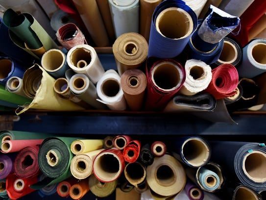 Rolls of material used to cover books at LoGatto Bookbinding