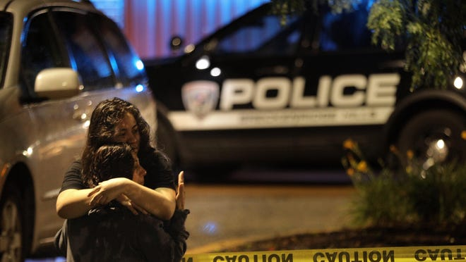 Bystanders embrace outside an Applebee's restaurant on Monday, June 22, 2020, in St. John, Mo., a suburb of St. Louis after a gunman opened fire inside the business killing one and injuring at least two other people inside.Photo by Christian Gooden, cgooden@post-dispatch.com