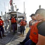 This photo taken Jan. 28, 2014, shows the crew of a 45 foot Coast Guard patrol boat runs through their pre-departure briefing in San Diego harbor in San Diego. Once the vessel exited the harbor area it encountered a dense fog. With the drug war locking down land routes across Latin America and at the U.S. border, smugglers have been increasingly using large vessels to carry multi-ton loads of cocaine and marijuana hundreds of miles offshore where the lead federal agency with extensive law enforcement powers is the Coast Guard, a military service roughly the size of the New York Police Department.