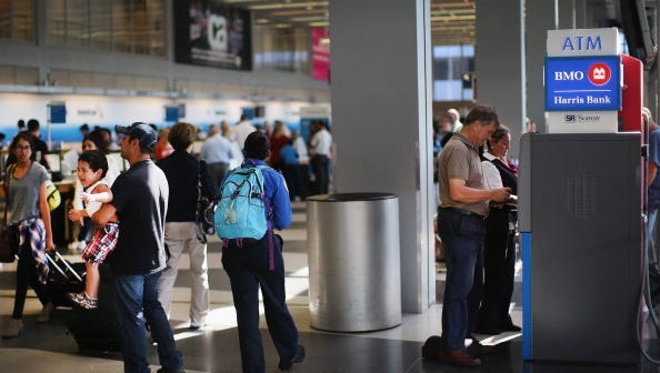 Travelers inside O'Hare airport