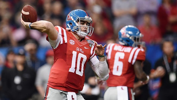 Quarterback Chad Kelly (10) throws a pass during the Sugar Bowl.