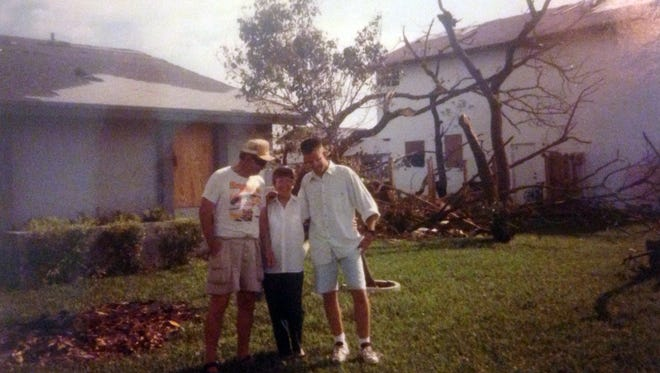 Jay Schlichter, right, stands next to his parents outside their house in Homestead, Fla., after Hurricane Andrew in August 1992.