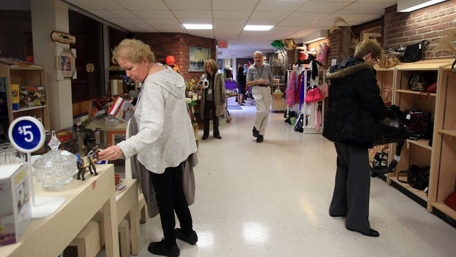 People shop during the Grand Opening of Helen's Hope Chest at Helen Hayes Hospital in West Haverstraw on Thursday.