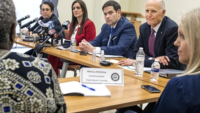 Dr. Alina Alonso, Palm Beach County health director (from left), Florida Lt. Gov. Jeanette Nunez, U.S. Sens. Marco Rubio and Rick Scott, and Palm Beach County Commissioner Melissa McKinlay listen Friday to Palm Beach County Administrator Verdenia Baker during a coronavirus roundtable at the Palm Beach County Health Department.