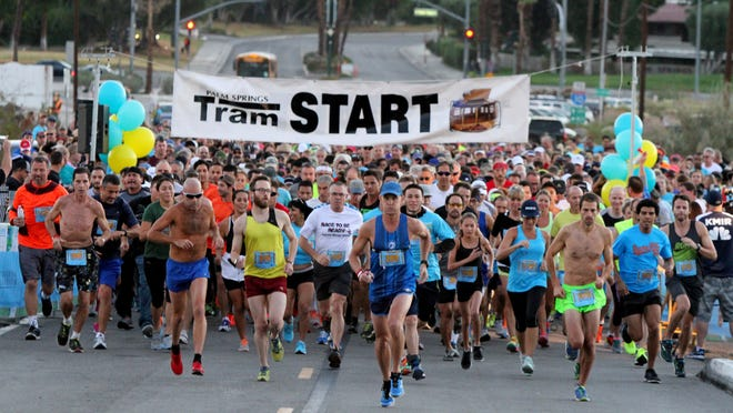 Runners take off in the Tram Road Challenge in Palm Springs on <137>Saturday, <137>Oct. 25. <137>, 2014.<137>