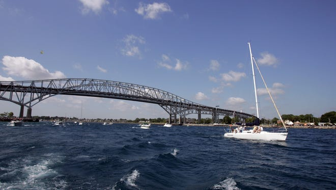 Yachts pass under the Blue Water bridge