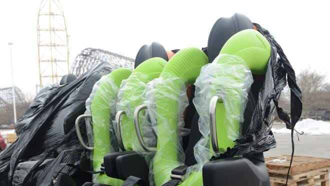 In this file photo, cars of the Rougarou sit in the parking lot at Cedar Point waiting to be unwrapped and installed on the roller coaster.