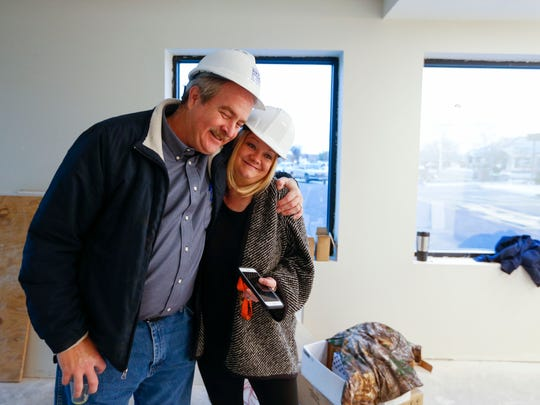 Rich Kramer of Rich Kramer Construction gives a hug to Esther Munch, Harmony House's director of marketing, during a tour of Harmony House's new facility on Wednesday, December 28, 2016.