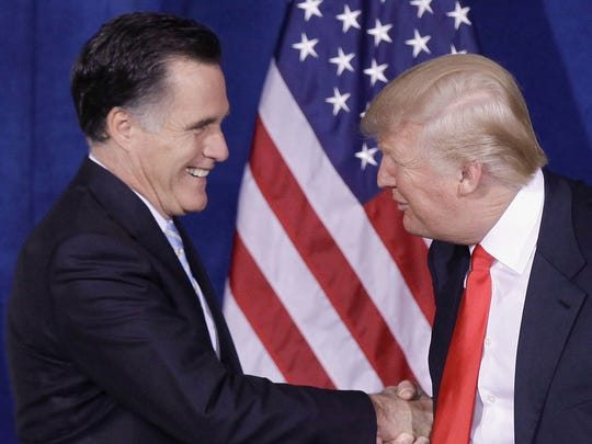 Donald Trump greets then-Republican presidential candidate, former Massachusetts Gov. Mitt Romney, after announcing his endorsement of Romney, during a news conference in  Las Vegas on Feb. 2, 2012.