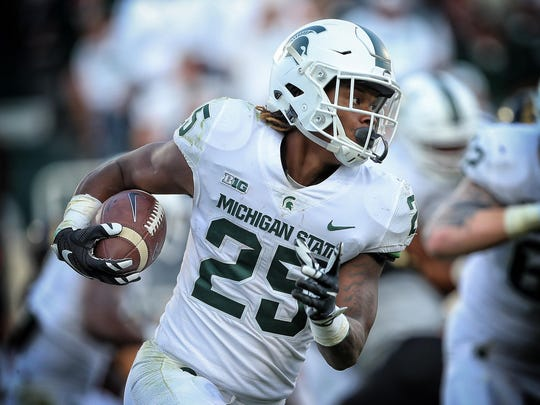 Michigan State, in its all-white uniforms, rolled to